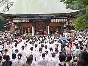 Crowds waiting to carry portable shrine, Yasaka shrine, Kyoto, Japan, photo