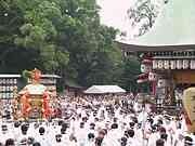 Crowd bearing portable shrine, Yasaka shrine, Kyoto, Japan, photo