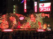 Nebuta and neon signs, Nebuta Festival, Aomori, Japan, photo