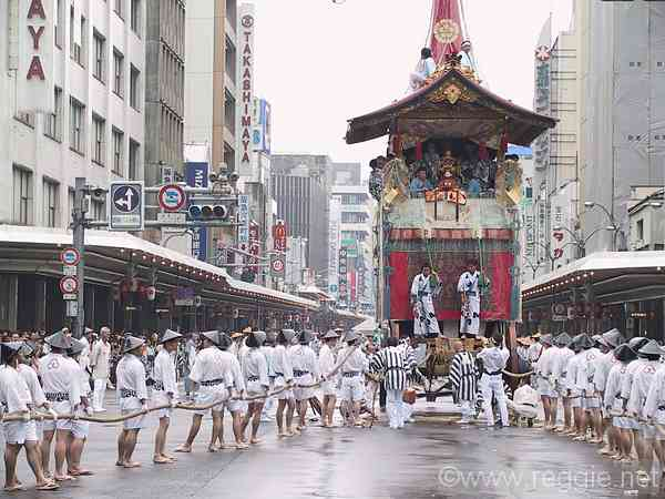 People pulling float, Gion Matsuri parade, Kyoto, Japan, photo