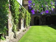 Hanging baskets, Cloister Court, England, photo