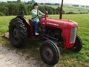 Ayaka on tractor, Camping Barn, near Bakewell, Derbyshire, England, photo