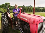 Akiko on tractor, Camping Barn, near Bakewell, Derbyshire, England, photo