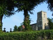 St. Botolph\'s Church through trees, Hadstock, Essex, England, photo