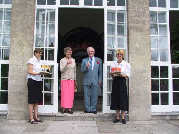 Mum and Dad with ladies serving drinks by Orangery, photo