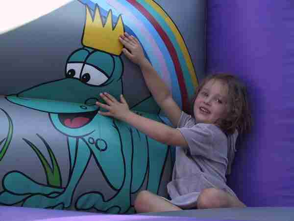 Madeleine on bouncy castle, photo