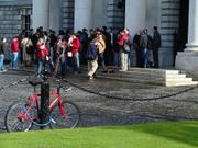 Students by public theatre, Trinity College, Dublin, Ireland, photo