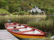 Kylemore Abbey and boat, Co. Galway, Ireland, photo