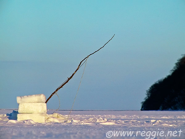 Fishing line on ice on lake Komuke, Hokkaido, Japan, photo